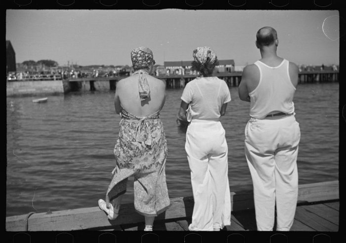 6. Locals watching a tourist boat arrive from Boston in Provincetown.