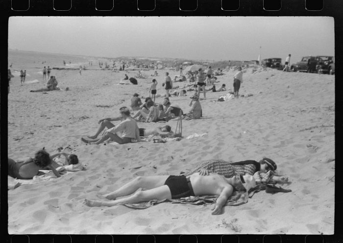 9. Heading to the beach is a cheap and fun reprieve from the toil of daily life. Bathers relax on the shores of Provincetown.