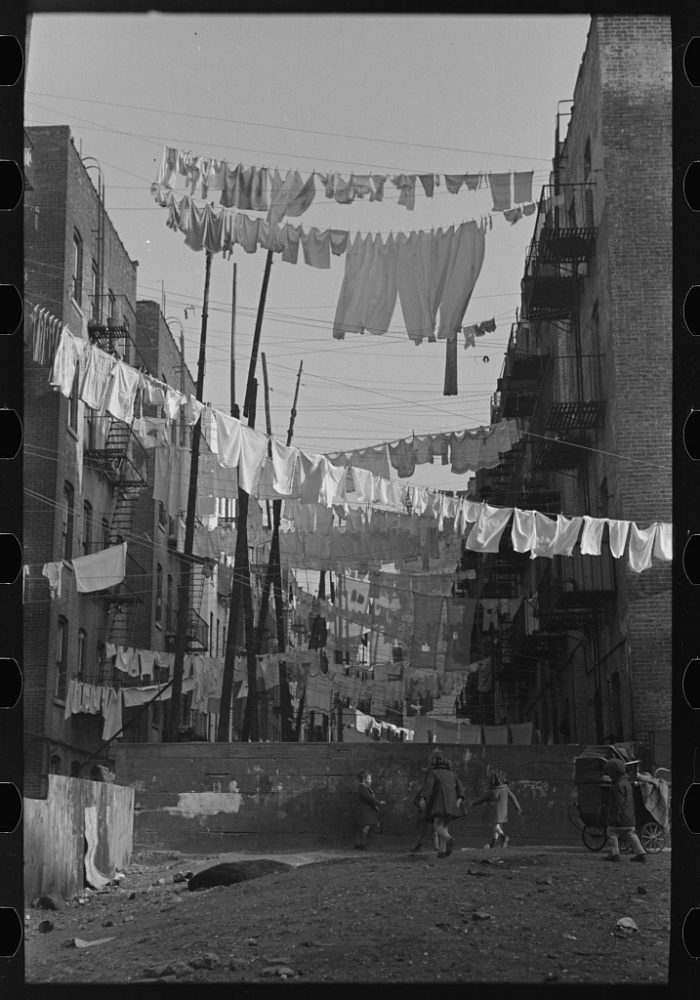 6. An avenue of laundry between 138th and 139th Street apartments, just east of St. Anne's Avenue, Bronx, New York City.
