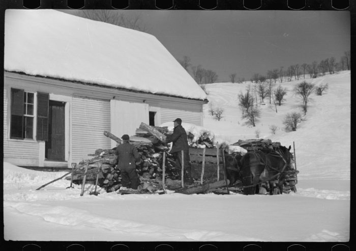 2.  Mr. Gilbert and hired man hauling wood for winter fuel in Woodstock.