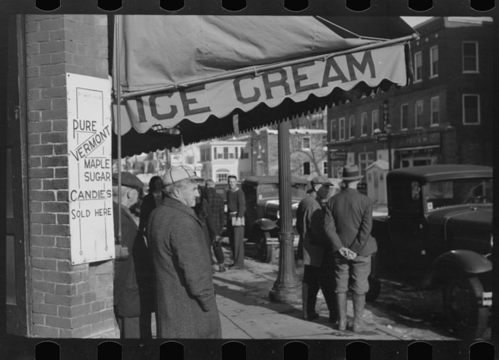 4.  Townspeople of Woodstock, Vermont, discussing the severe winter on the street corner in center of town.