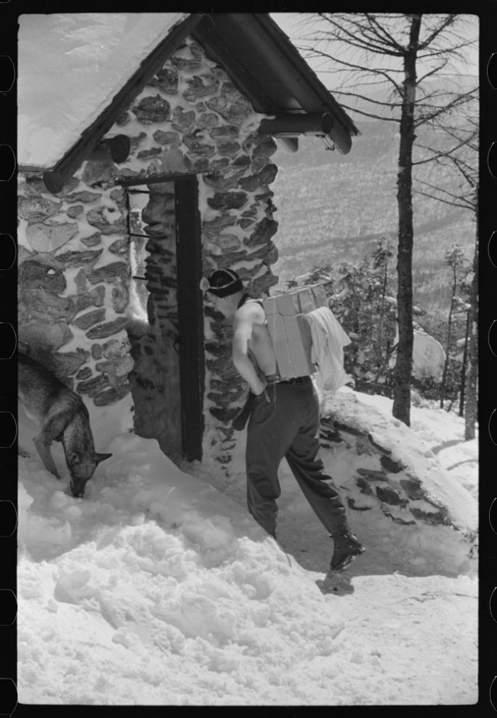 7.  Forest ranger bringing in supplies which he has carried up the mountain on skiis to his hut which is also used by skiers in the winter. About half an hour later on his next trip down the mountain on skiis for more supplies he broke his leg. Near the top of Mount Mansfield, Smuggler's Notch, near Stowe.
