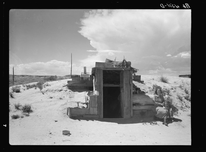 3. Earth dugouts, like this one near Rapid City, provided shelter to many during the hardships of the Dust Bowl. 1936