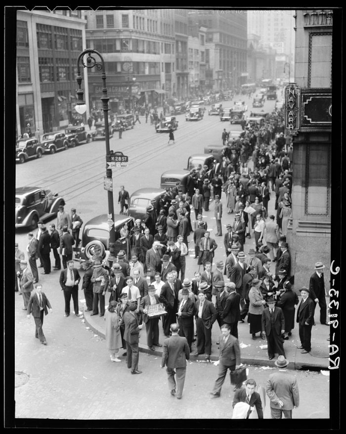 5. Garment workers leave the factories for lunch hour on Seventh Avenue and West 28th Street, New York City.