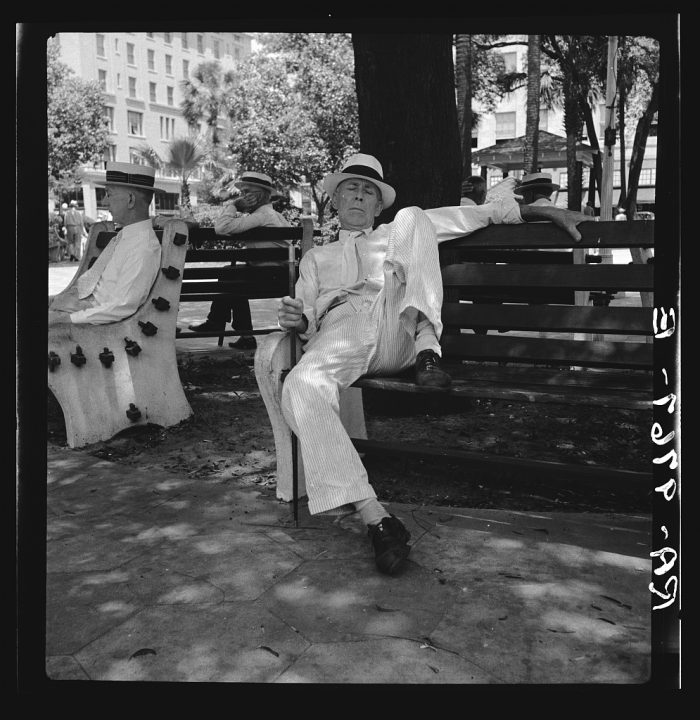 8. A man lounging in a downtown park in Jacksonville.