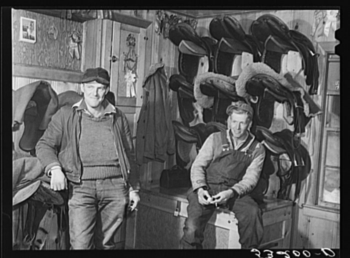 14.  Hired help resting after a day's work on Upwey horse farm.