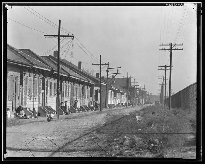 16. A slum street in New Orleans.
