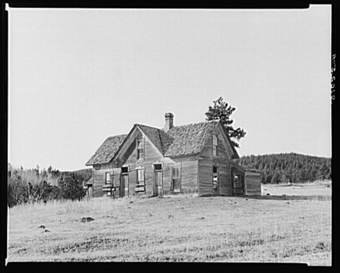 8. A lone homestead out in the Black Hills. Though weathered and old, it was still inhabited at this time. 1937