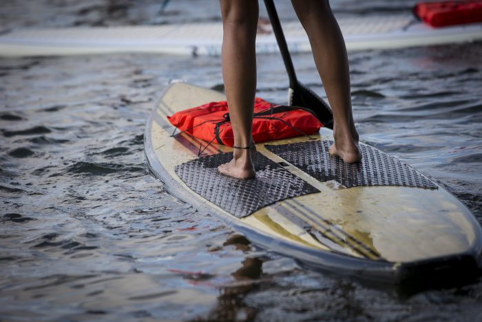 2. Test your balance on a stand up paddle board.