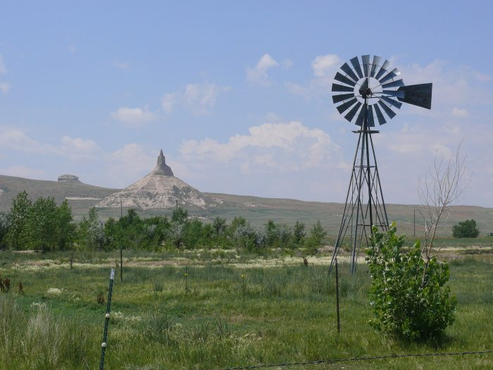 22. What a spectacular view! A windmill sits in the foreground while Chimney Rock sits quietly in the background.