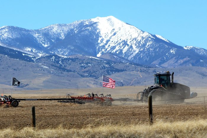 5. This patriotic farmer has a view of the Tobacco Root Mountains from his Madison County farm.