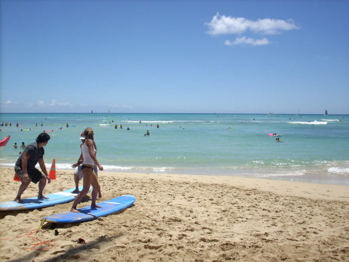 5. On Waikiki Beach, you will almost always find an endless supply of first-tiime surfers.