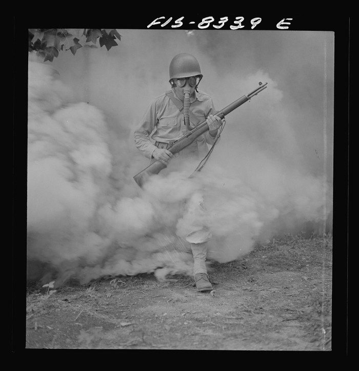 12. A soldier trains to use a gas mask in simulated exercises at Fort Belvoir, Virginia.