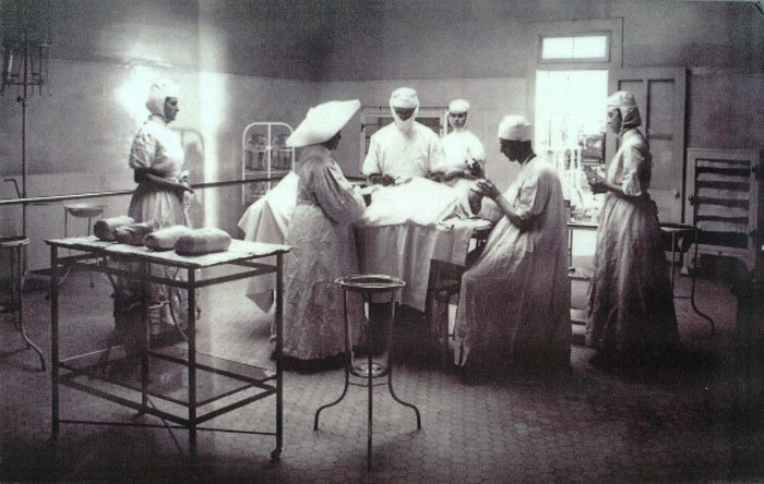8. Doctors and nurses surround a patient in this Interior photo of the Los Angeles Infirmary in 1908. Located at Sunset and Beaudry, this location later became St. Vincent's Hospital.