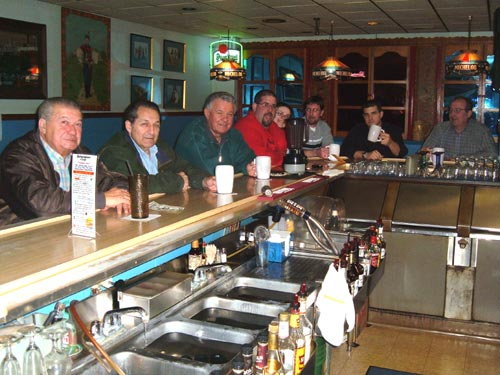 Patrons enjoy bellying up to the bar to enjoy a pivo (beer) or two while chatting with friends.