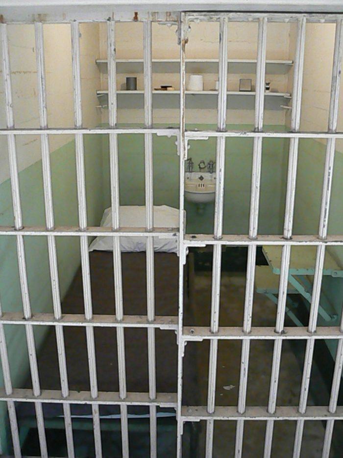 Prison cell with bed inside Alcatraz main building san francisco california-3557791151