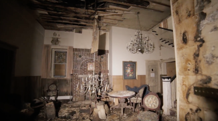 The waterlogged building is filled with original furniture and old photographs.