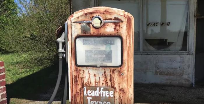 An old gas pump stands outside the building, rusted yet still charming.