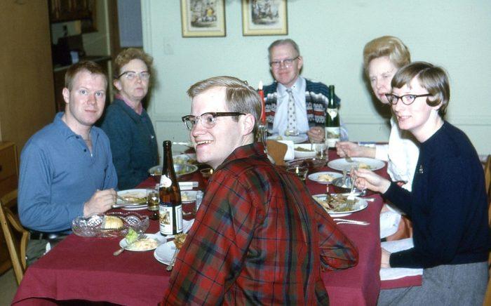 7. A family enjoys dinner in 1965.