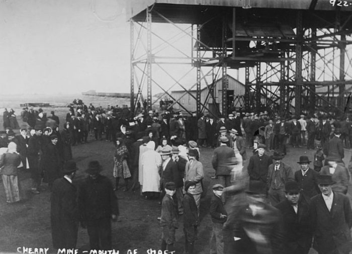 3. A crowd gathers around the mine shaft as news spreads of the disaster.