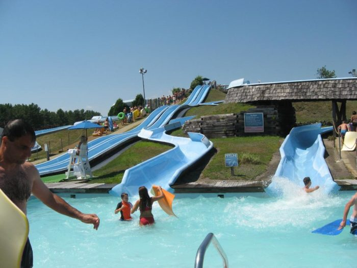13. Slide your way to fun at a water park.