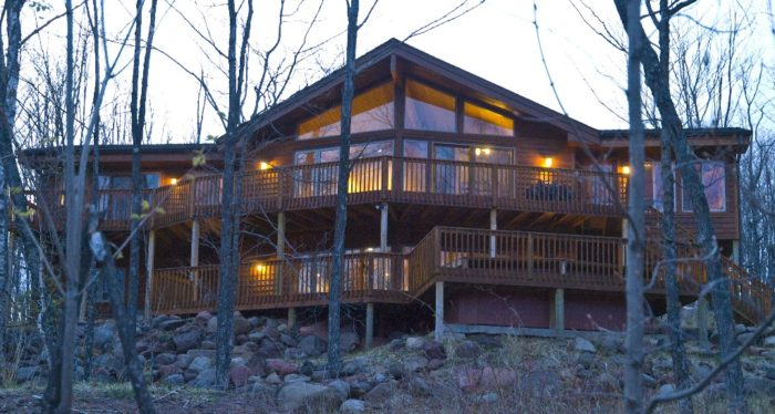 6. Summit Retreat is a stunning cabin on Lake Superior that sleeps 12 with an amazing deck and a lower floor with plenty of fun including a pool table & game table.