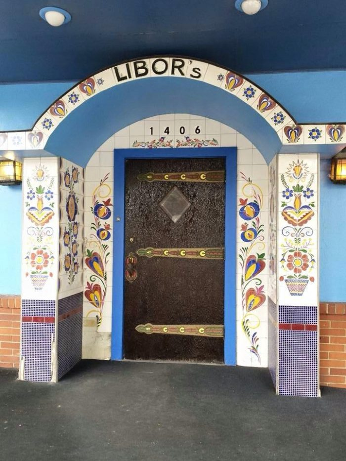 """Stepping into the restaurant, you'll see """"Libor's"""" set into the tile in the archway above the door. Libor was the name of the family who bought the restaurant in 1947; the same family has been operating the restaurant ever since."""