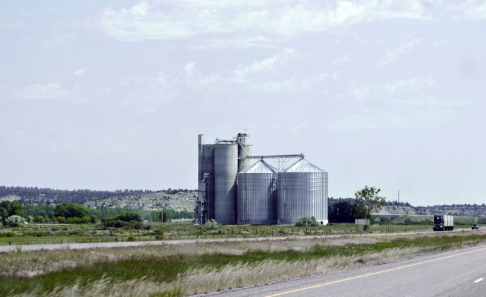 8. The grain elevators on this Miles City farm look enormous even from the road.