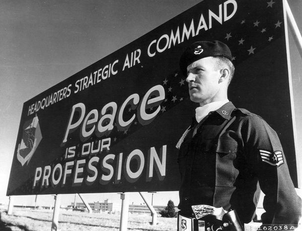 1. A young Staff Sargent guards the SAC headquarters entrance in 1959.