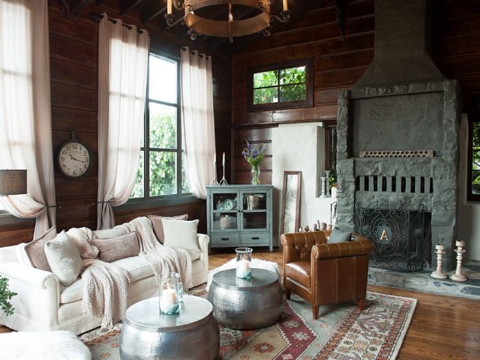 Owned by retired SFPD lieutenant, Bill Gilbert, and his wife, the house is beautifully styled. Imagine luxuriating in this cozy, wood-paneled living room…