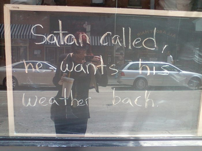 """4. Everywhere we go, we are reminded of the heat, like this sign that reads: """"Satan called, he wants his weather back."""""""