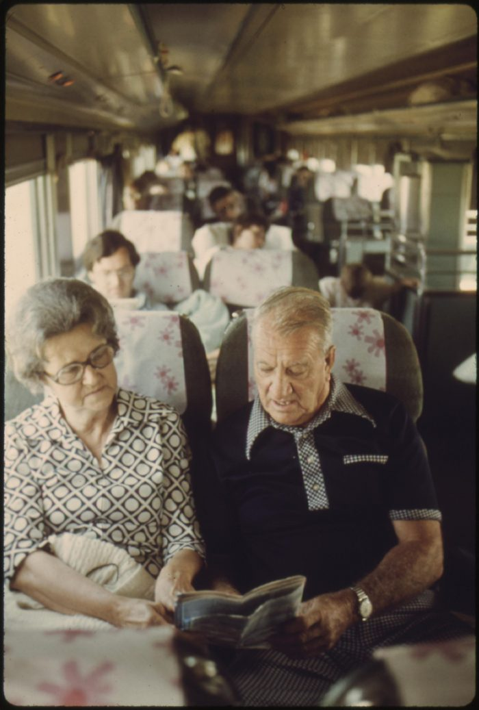 11. This couple is onboard Amtrak's Lone Star as it just crossed over into Oklahoma. They are discussing their plans in a passenger car,  June of 1974.