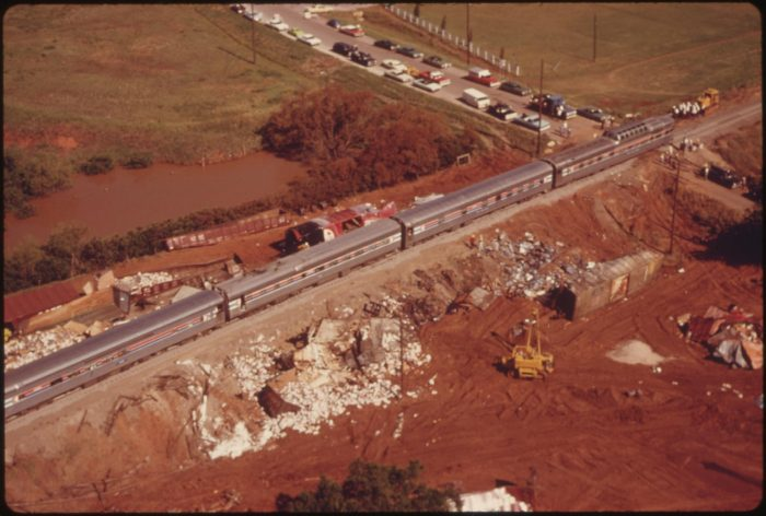 12. The Lone Star passenger train slowly makes its way past debris which resulted from a freight train derailment in Oklahoma. The derailment disrupted rail traffic for two days, June of 1974.