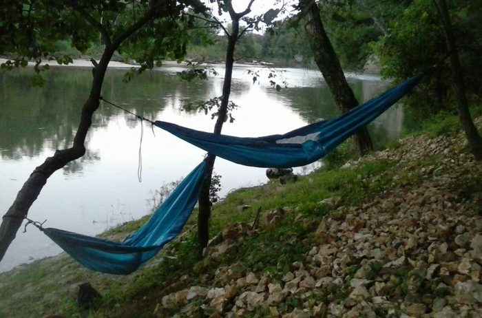 Try out hammock camping right along the edge of the Illinois River.