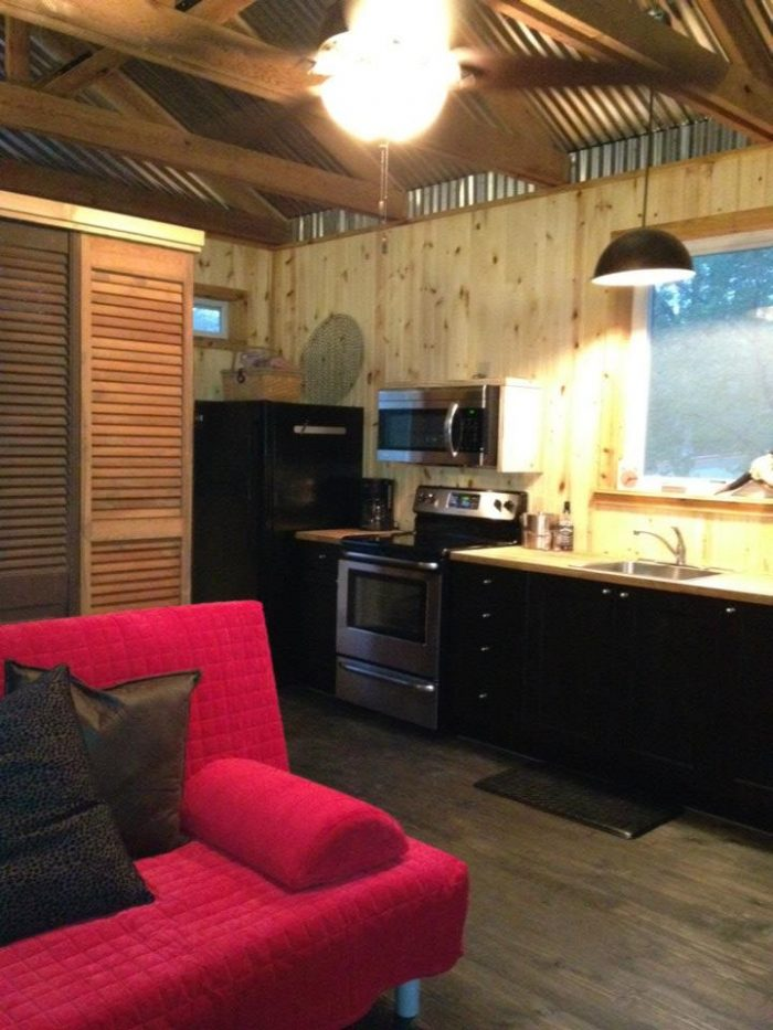 The inside cabin has a refrigerator, stove, oven and many other amenities.