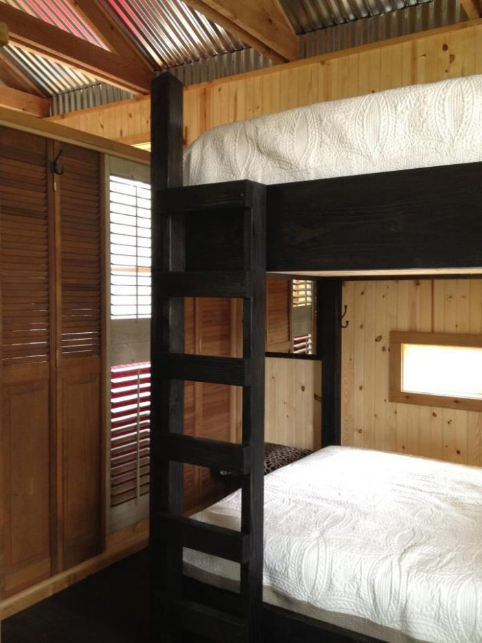 The inside cabin is very cozy and offers bunk beds for sleeping.