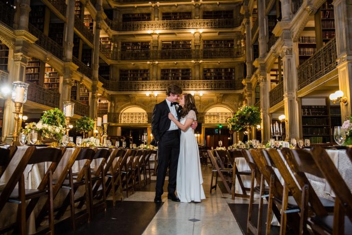 And look at this couple, happily surrounded by grandeur. This dreamy place is the perfect wedding venue for lovers of books, architecture, and fairy tales.
