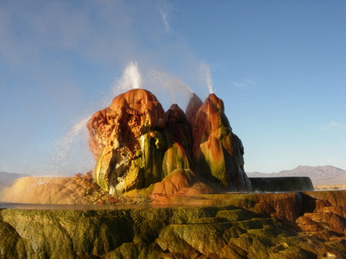 Fly Geyser's bright red and green colors are due to thermophilic algae.