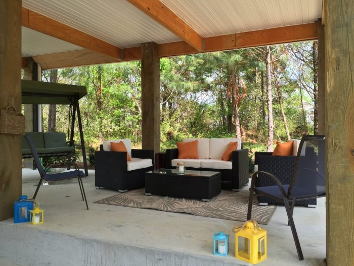 Spend time relaxing or dine outside in the covered area underneath the home.