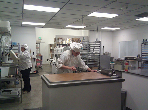 As you walk through the factory, you'll be able to see the confectioners at work through large windows. Here's a photo of someone making caramel.