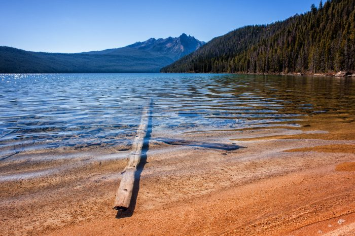 Redfish Lake is a picturesque piece of Idaho's beautiful Sawtooths region. Here, you can see straight to the bottom of the crystal-clear water.