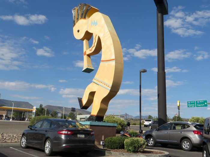 11. The World's Largest Kokopelli—which stands 32 feet tall—is found standing in front of a Starbucks and taco shop.