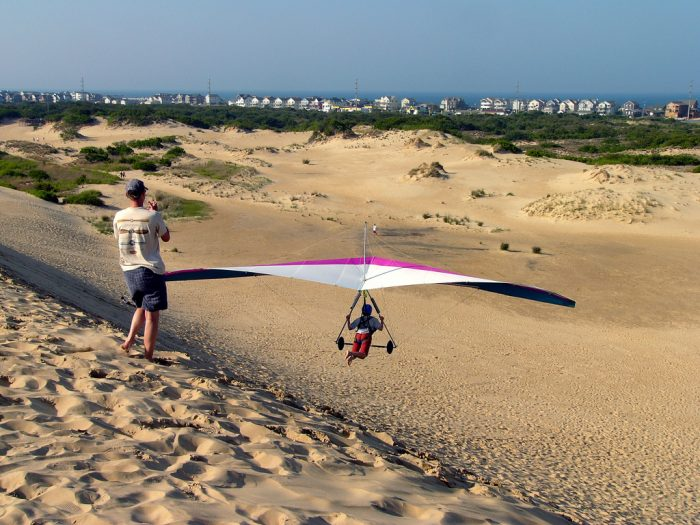 4. Simply visit OR hang glide off the tallest active sand dune on the East Coast, Jockey's Ridge.