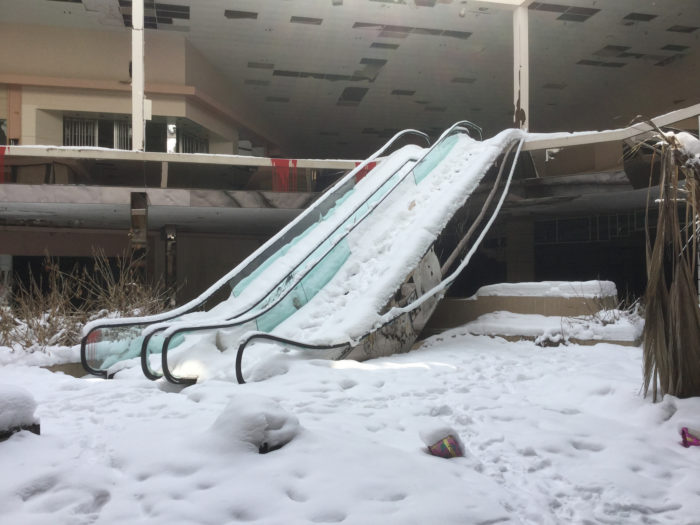 Today, the glass ceiling of the mall has collapsed in places, allowing snow and rain to enter the building.