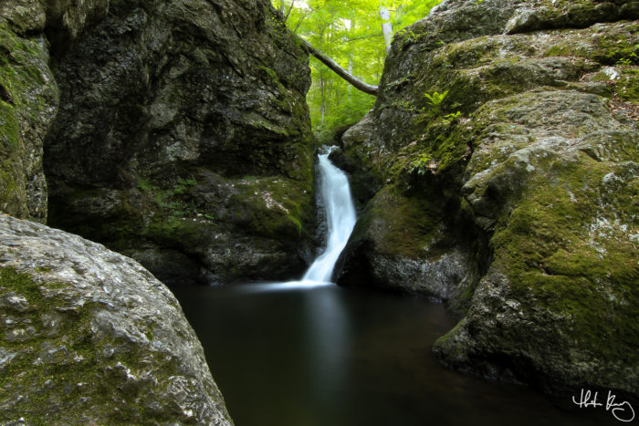 The water from Indian Hole Brook comes cascading down the rocks for a fifteen foot drop!