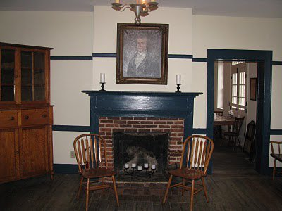 A portrait of J. Huston hangs in one of the dining rooms.