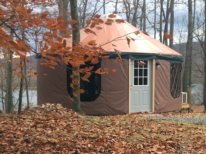 ...Opt for the comfy yurt. (No ensuite bathroom but, don't worry, you've got a TV!)