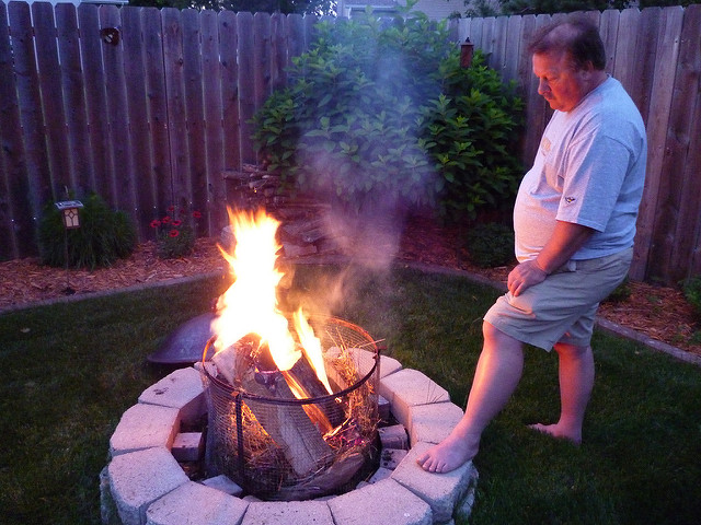 3. Lighting a campfire to share with friends or family.