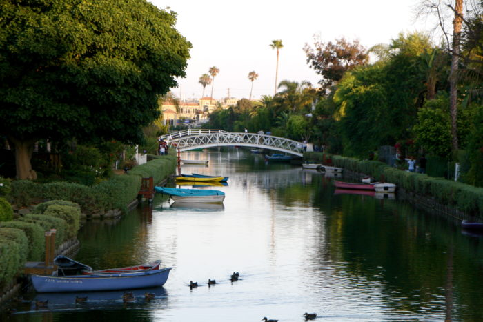 The Venice Canal Historic District, located in a residential area of Los Angeles, is full of picturesque man-made canals and walking bridges perfect for a leisurely afternoon of strolling and picture taking.
