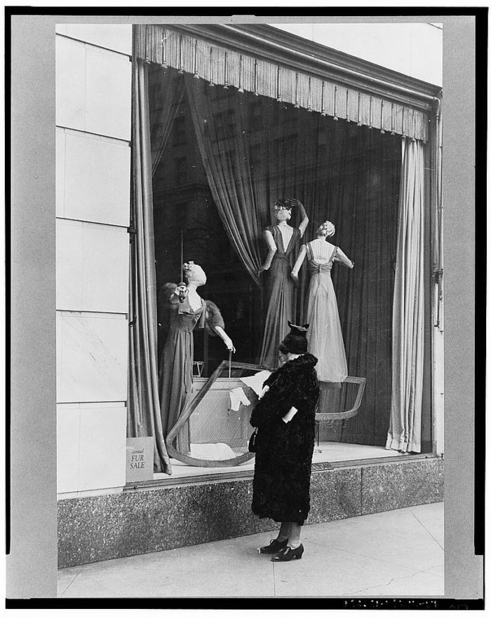 15. We'll never stop window shopping! Here you can see someone looking at the display in Bergdorf Goodman.